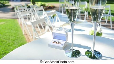 Wedding rings and glasses of champagne.