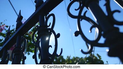 Edge of an old spiked iron railing against the shinning sun....