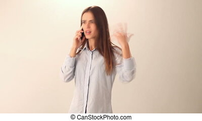Woman quarreling on the phone - Young woman in blue shirt...