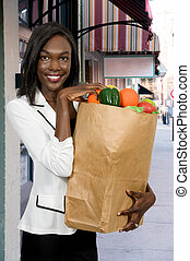 Woman with a Shopping Bag - Beautiful young black African...