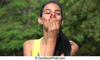 Pretty Woman Blowing A Kiss And Winking