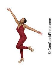 Woman Dancing - Beautiful young black woman dancing the...