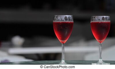 Two glasseses of rose wine dark background
