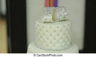 Closeup of white wedding cake.