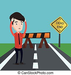 Businessman looking at road sign dead end - Young...