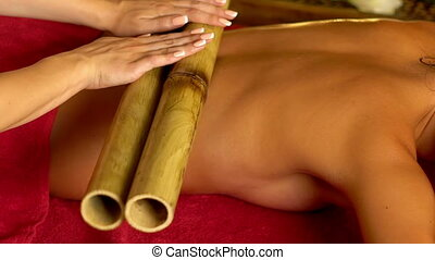 Close up of woman have bamboo sticks therapy massage. -...