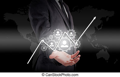 Businessman holding a concept of the increase and growth of statistics in business