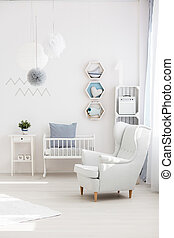 Armchair in baby room - White elegant armchair in inspiring...