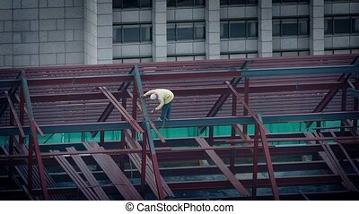 Man Soldering Beams Of New Building - Worker solders large...