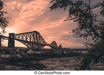 Forth Rail Bridge at dusk in Edinburgh, Scotland, connecting...