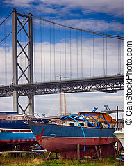 Boats in front of the Forth Road Bridge in Edinburgh,...