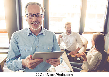 Business people working - Handsome mature businessman in...