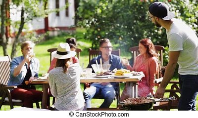 friends having barbecue party at summer garden - leisure,...