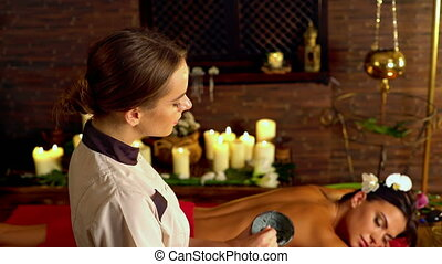 Massage and clay body mask in spa salon. 4k - Young woman...