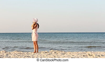 girl in hat on the beach