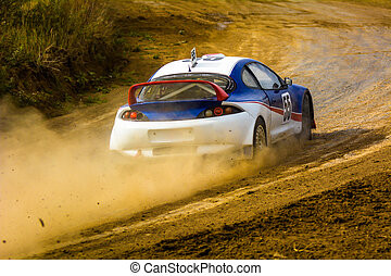 Racing speed car on a dusty road.