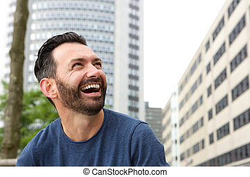 Mature guy with beard laughing