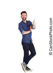 Confident mature man standing and showing thumbs up - Full...