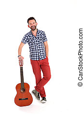 Smiling mature man with guitar - Full length portrait of...