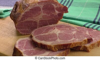Carved ham on a wooden board