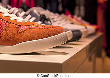 leather shoes retail shop in rows varied colors - classic...