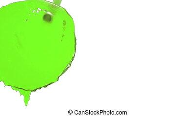 flow of green liquid paint falls the screen. juice - flow of...