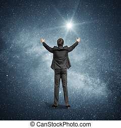 Man standing on the background of the night sky, the Milky...