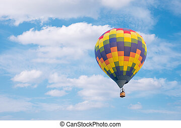 Hot air baloon with clouds blue sky background