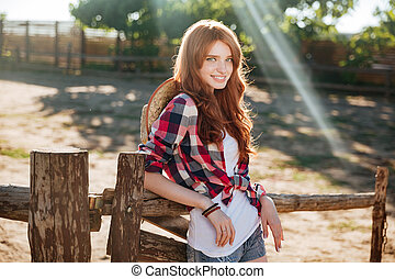Happy woman cowgirl standing and relaxing on ranch - Happy...