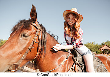 Happy pretty young woman cowgirl riding horse - Happy pretty...