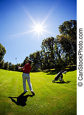 Young white male golfer red shirt - One young white male...