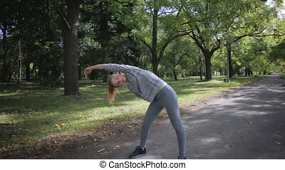 Girl doing exercise with slopes - Young and beautiful girl...