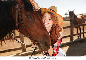 Happy tender young woman cowgirl hugging her horse - Happy...