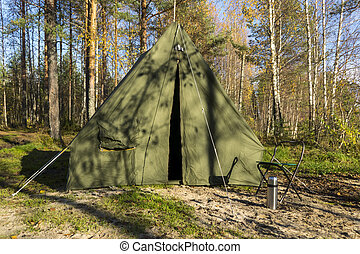 Oldschool tent in forest camp - Retro tent in forest in the...