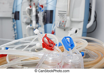 Blood tubes with hemodialysis machine in the background....