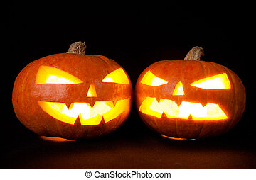 Halloween pumpkins smile and scary eyes for party night...