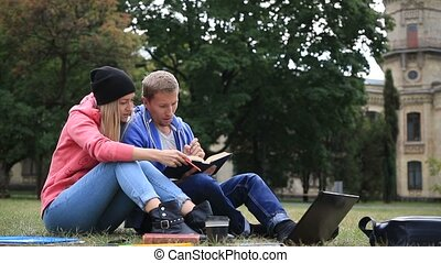 Couple of students enjoying student life - Young college...