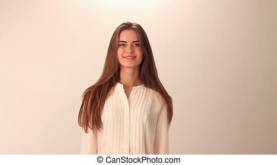 Woman showing happiness - Young pretty woman in white blouse...