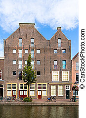 Warehouses on Old Rhine canal in Leiden, Netherlands