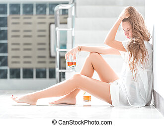 Girl in depression drinking alcohol in solitude - Girl in...