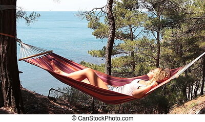 young girl resting in a hammock - Beautiful young girl...
