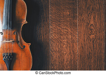 Violin on wooden floor - Top view of violin placed...