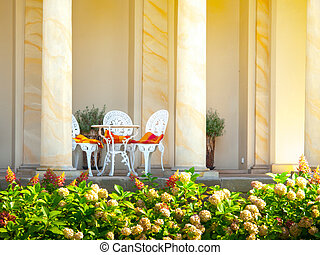 Romantic set of tables and chairs in archway - Romantic set...