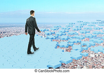 Man walking on puzzle road - Man walking on abstract blue...