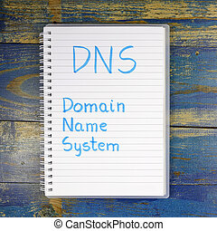 DNS- Domain Name System written in notebook on wooden...