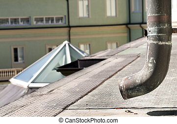 Roof gutter - Copper rusty roof gutter from a top of an...