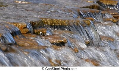 Brook water stream with small rift - Brook or river running...