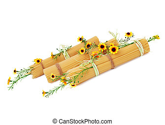 Italian spaghetti decorated with yellow flowers. - Uncooked...