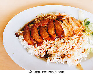 closeup roasted red pork with sweet gravy on steamed rice -...
