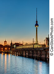 Sunset at the river Spree in Berlin with the TV Tower